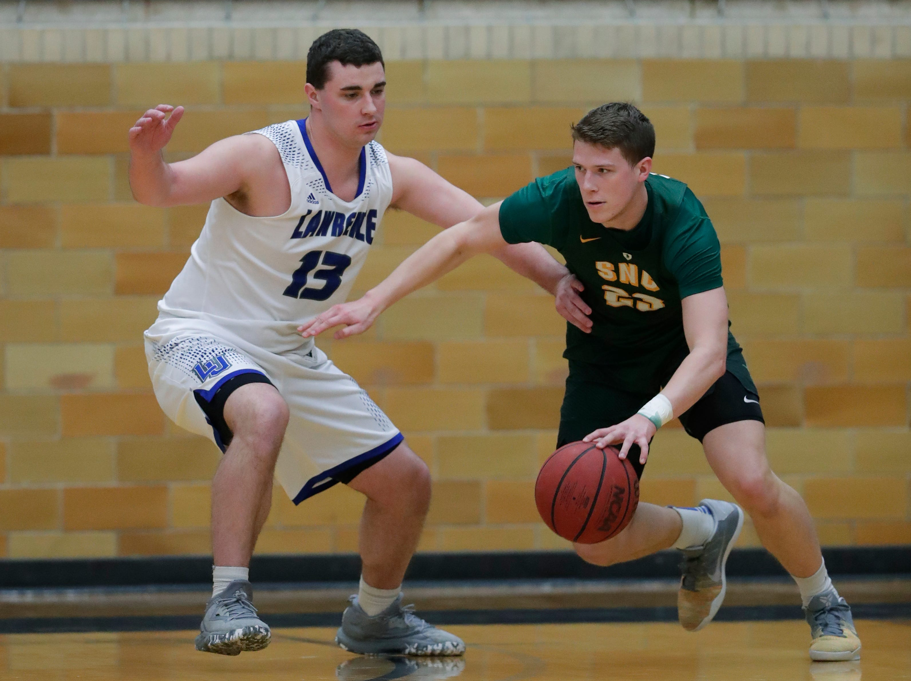 Lawrence University's Tyler Klug (13) defends against St. Norbert College's Drew Yetka (23) during their men's basketball game Thursday, January 31, 2019, at Alexander Gymnasium in Appleton, Wis. 