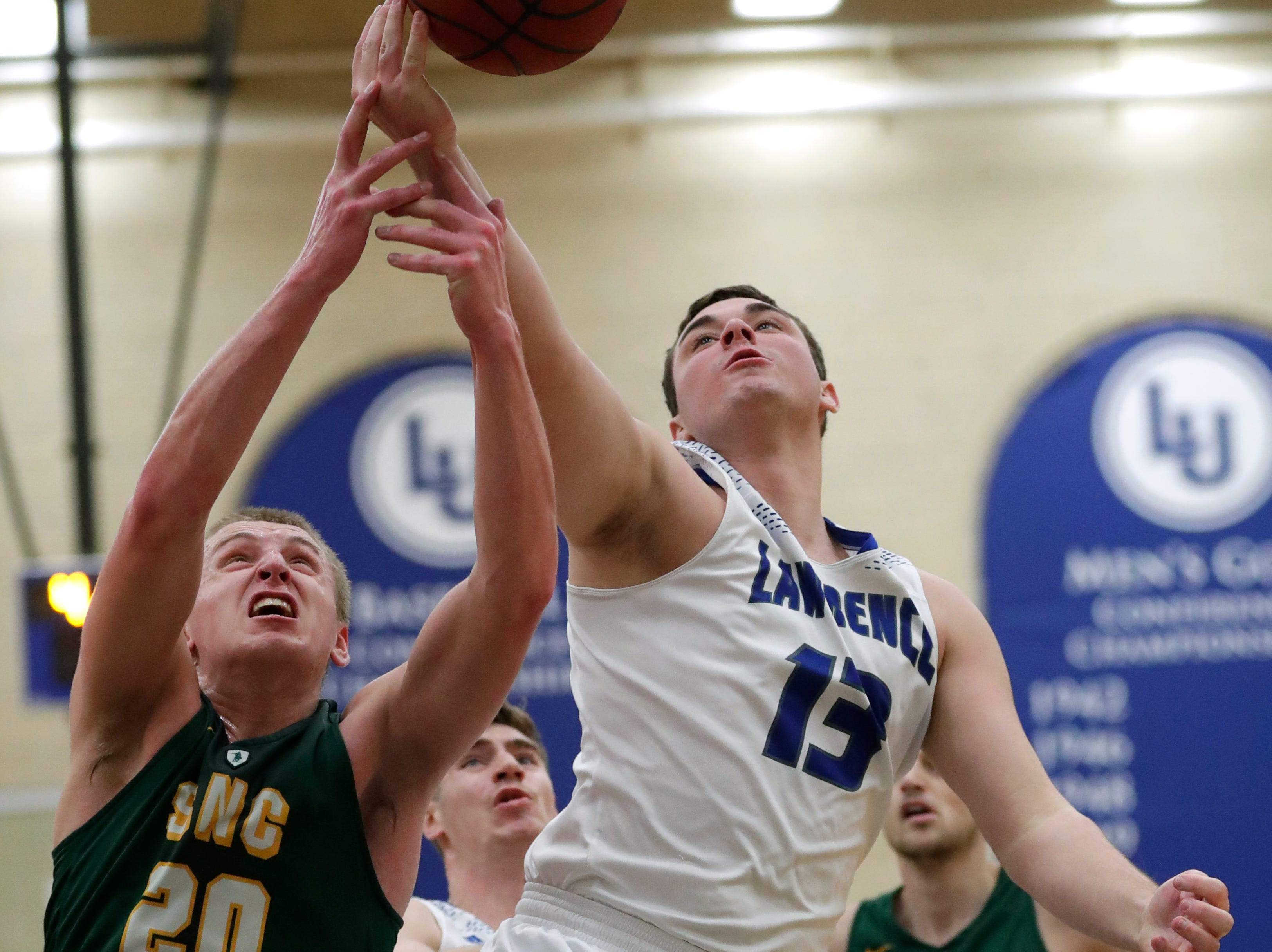 Lawrence University's Tyler Klug (13) battles for a rebound against St. Norbert College's Nolan Beirne (20) during their men's basketball game Thursday, January 31, 2019, at Alexander Gymnasium in Appleton, Wis. 