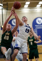 Lawrence's Tyler Klug (13) battles for a rebound against St. Norbert's Nolan Beirne (20) during their game Thursday at Alexander Gymnasium in Appleton.