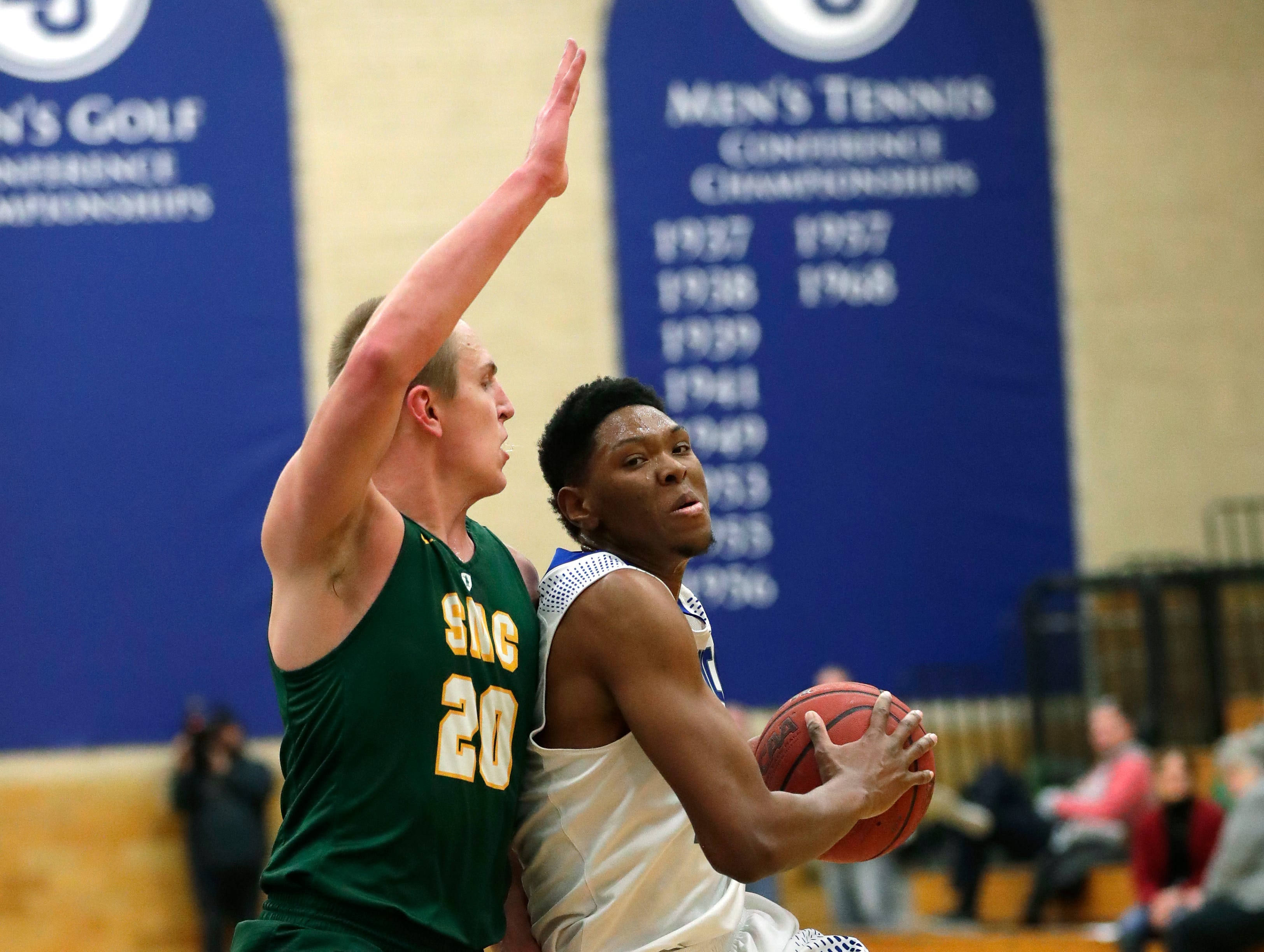 Lawrence University's Bryce Denham (23) drives to the basket against St. Norbert College's Nolan Beirne (20) during their men's basketball game Thursday, January 31, 2019, at Alexander Gymnasium in Appleton, Wis. 