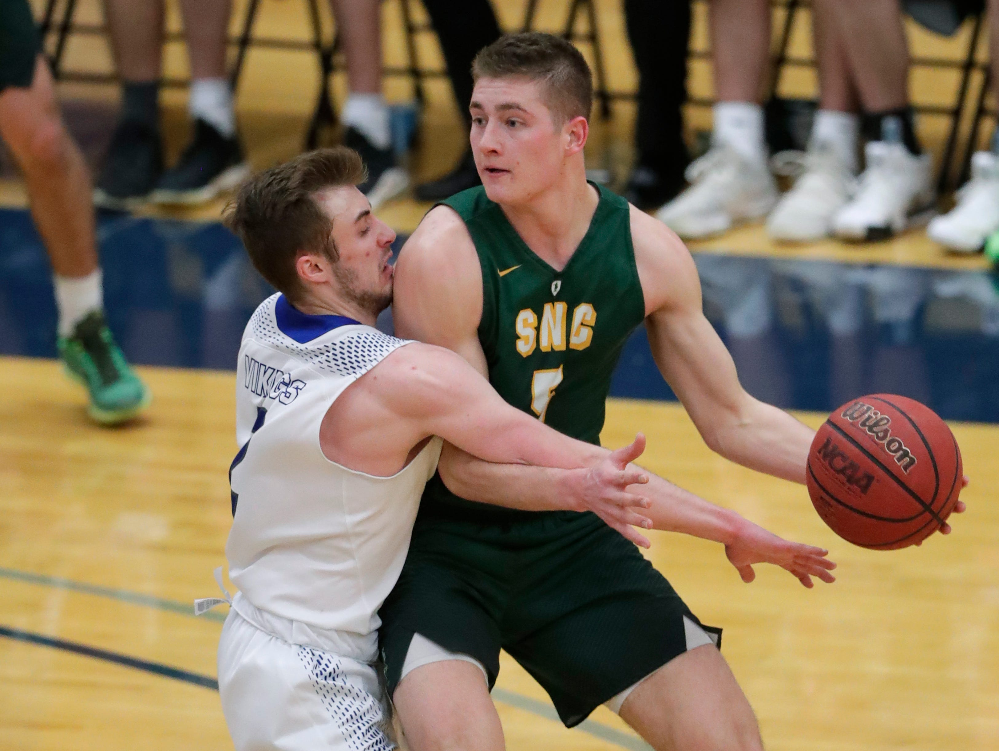 Lawrence University's Quinn Fisher (2) defends against St. Norbert College's Joe Ciriacks (5) during their men's basketball game Thursday, January 31, 2019, at Alexander Gymnasium in Appleton, Wis. 