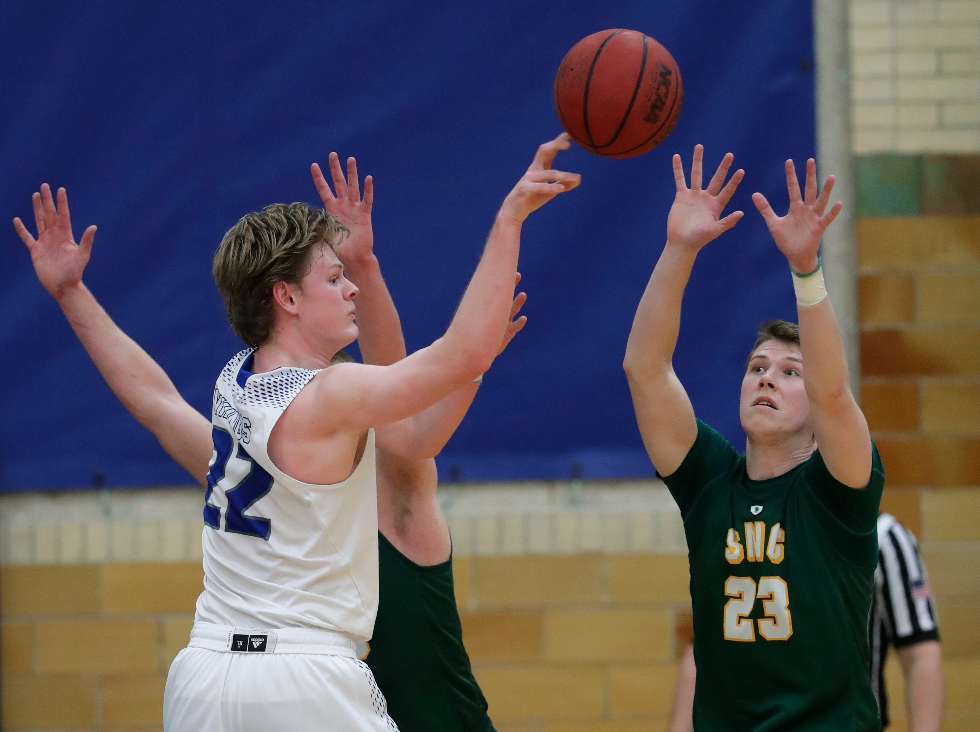 Lawrence University's Mason Materna (22) passes the ball against St. Norbert College's Drew Yetka (23) during their men's basketball game Thursday, January 31, 2019, at Alexander Gymnasium in Appleton, Wis. 