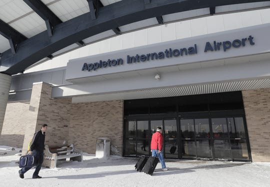Cody Dorner, left, of Green Bay and his father Sam Dorner of Luxemberg enter the Appleton International Airport Wednesday, January 30, 2019, in Greenville, Wis.  Dan Powers/USA TODAY NETWORK-Wisconsin