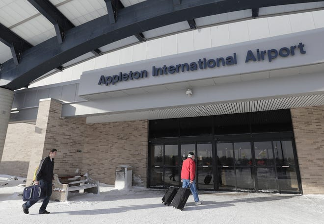 Cody Dorner, left, of Green Bay and his father Sam Dorner of Luxemberg enter the Appleton International Airport Wednesday, Jan. 30, 2019, in Greenville, Wis.