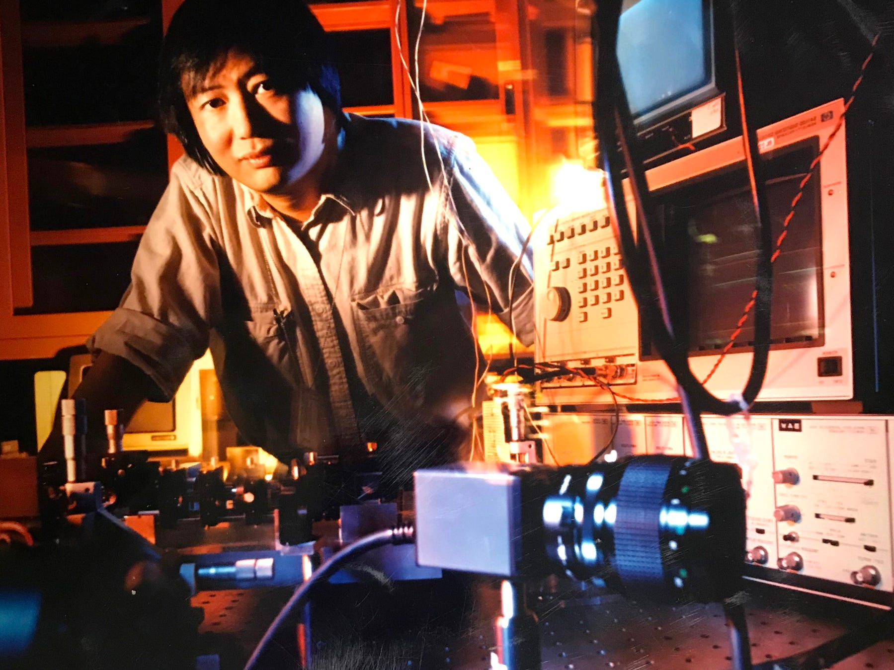 1990- Alan Huang, one of the AT&T Bell Laboratories research scientist who helped develop the world's first digital optical processor, in his labrotory. The optical processor, which makes use of light (photons), as opposed to electtrons, to process information, may eventually enable computers to operate 1,000 times faster then their electronic counterpart today.