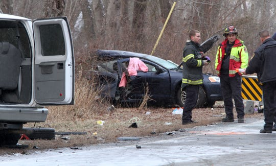 Jackson Township police and firefighers are shown at the scene of a two car collision on South Hope Chapel Road in the township Friday afternoon, February 1, 2019.