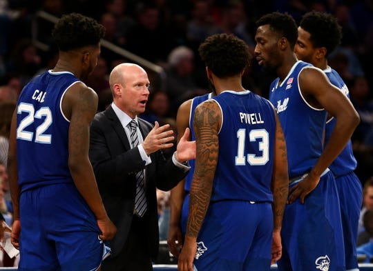 Seton Hall Pirates head coach Kevin Willard talks with his players in the second half of the Hoops Classic against the Kentucky Wildcats at Madison Square Garden.