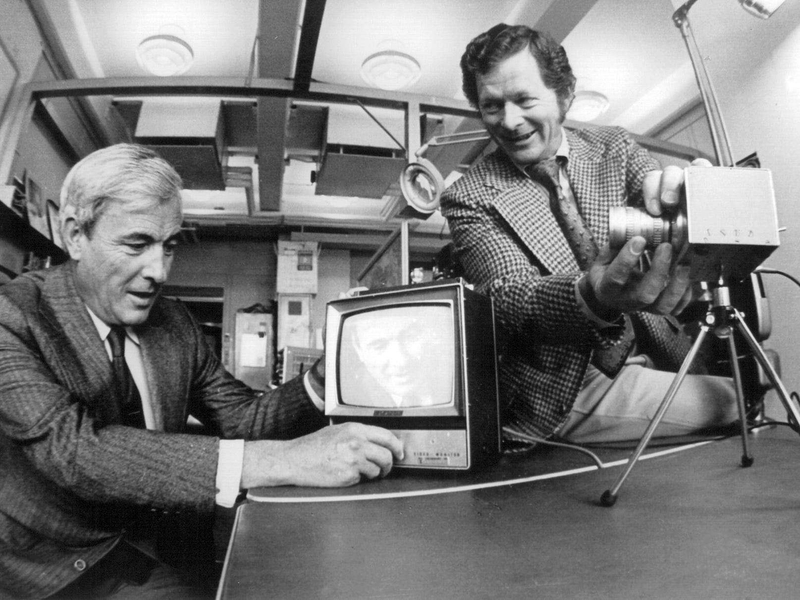 This Dec. 20, 1974 photo provided Tuesday Oct. 6, 2009 by Alcatel-Lucent shows Bell Labs researchers Willard Boyle, left, and George Smith at Bell Labs in Murray Hill, N.J., with the charge-coupled device, which transforms patterns of light into useful digital information. Smith and Boyle, and Charles K. Kao, whose research in the 1960s laid the foundation for digital images and lightning-fast communication shared the 2009 Nobel Prize in physics Tuesday for their work developing fiber-optic cable and the sensor at the heart of digital cameras.