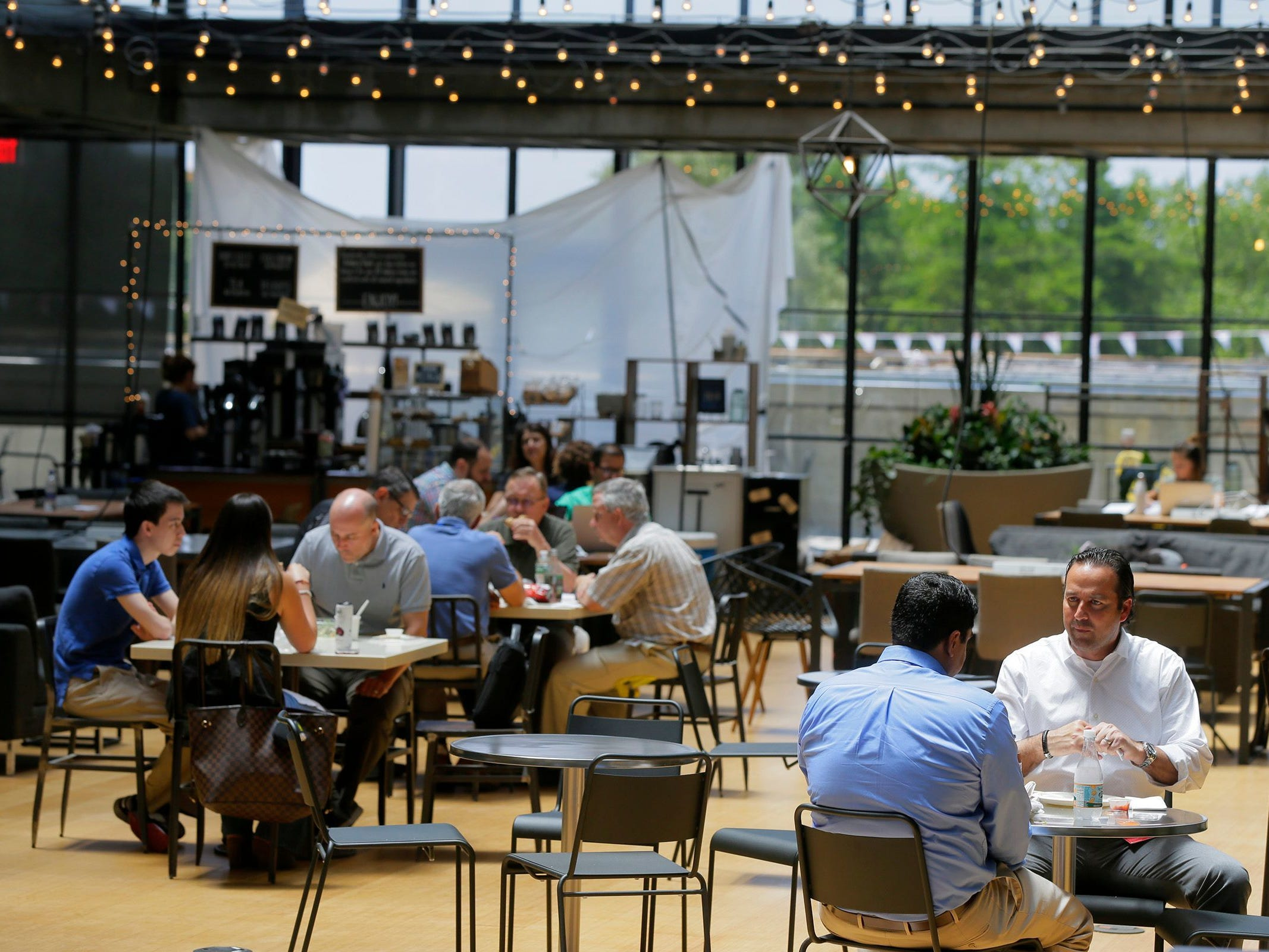 Workers eat lunch at Bell Works June 22 in Holmdel. $70 million in financing has been secured to continue upgrades in infrastructure and improvements for tenant spaces. Lunchtime at Bell Works, which is slowly becoming one of the hippest places to work in New Jersey, if not the country, in Holmdel, NJ Wednesday, June 22, 2017.
