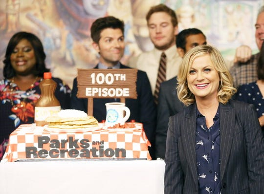 """Amy Poehler (R) and the cast of """"Parks And Recreation"""" attend the their 100th episode celebration held at CBS Studios - Radford on October 16, 2013 in Studio City, California."""