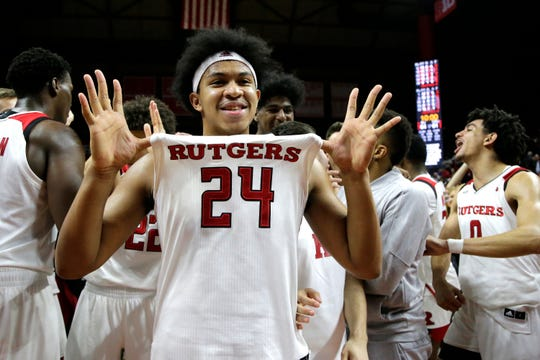 Rutgers forward Ron Harper Jr. celebrates after defeating Ohio State 64-61 during an NCAA college basketball game,