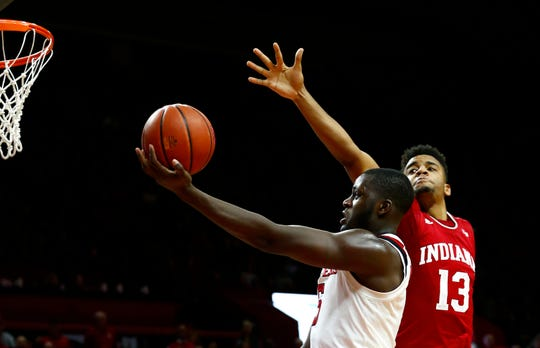 Rutgers Scarlet Knights forward Eugene Omoruyi (5) shoots the ball past Indiana Hoosiers forward Juwan Morgan (13) during the second half at Rutgers Athletic Center (RAC).