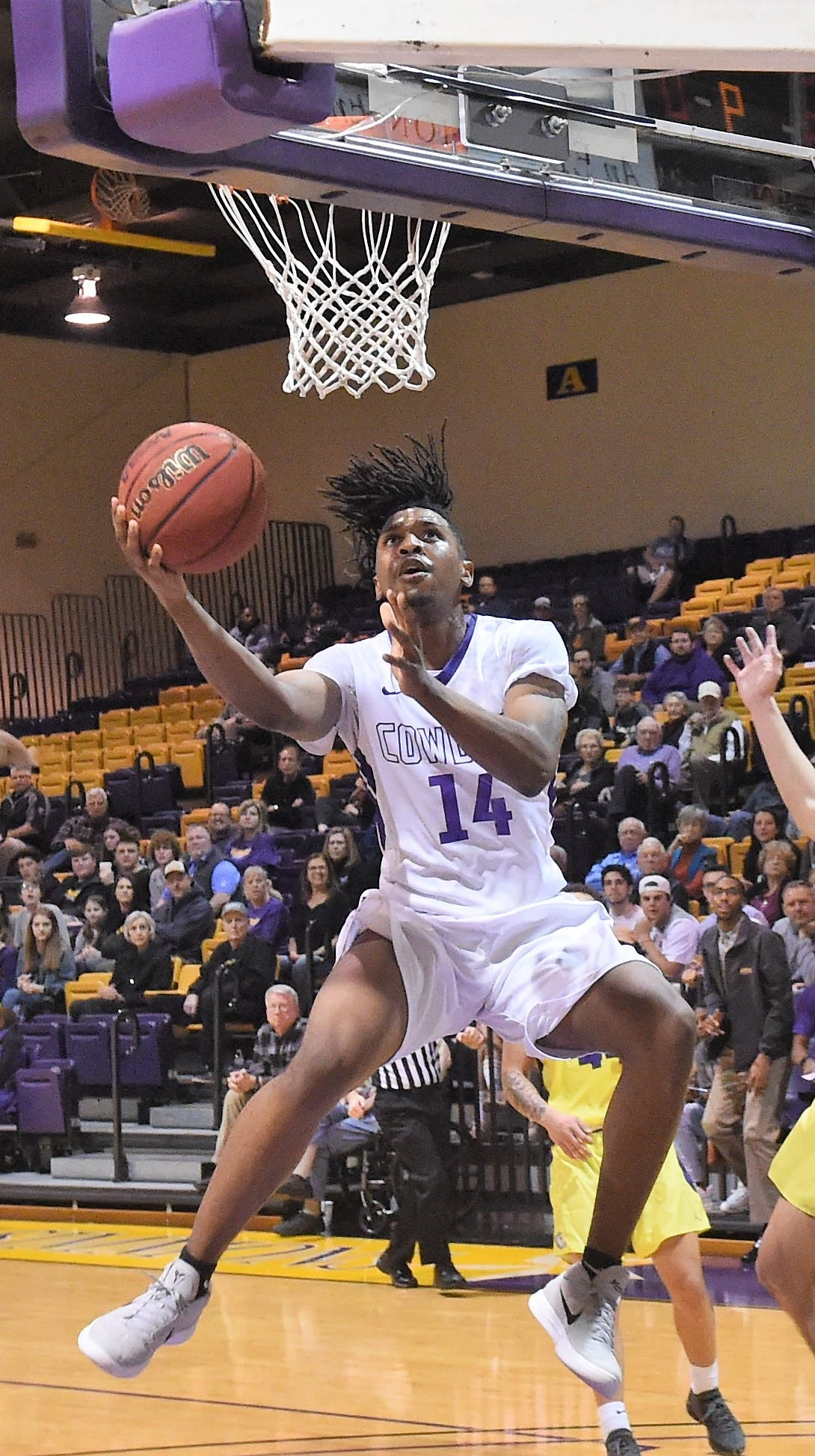 HSU's Steven Quinn (14) goes underneath the basket for a layup during the second half against Concordia at the Mabee Complex on Thursday, Jan. 31, 2019. The Cowboys won 76-67 to stay in the ASC West race.