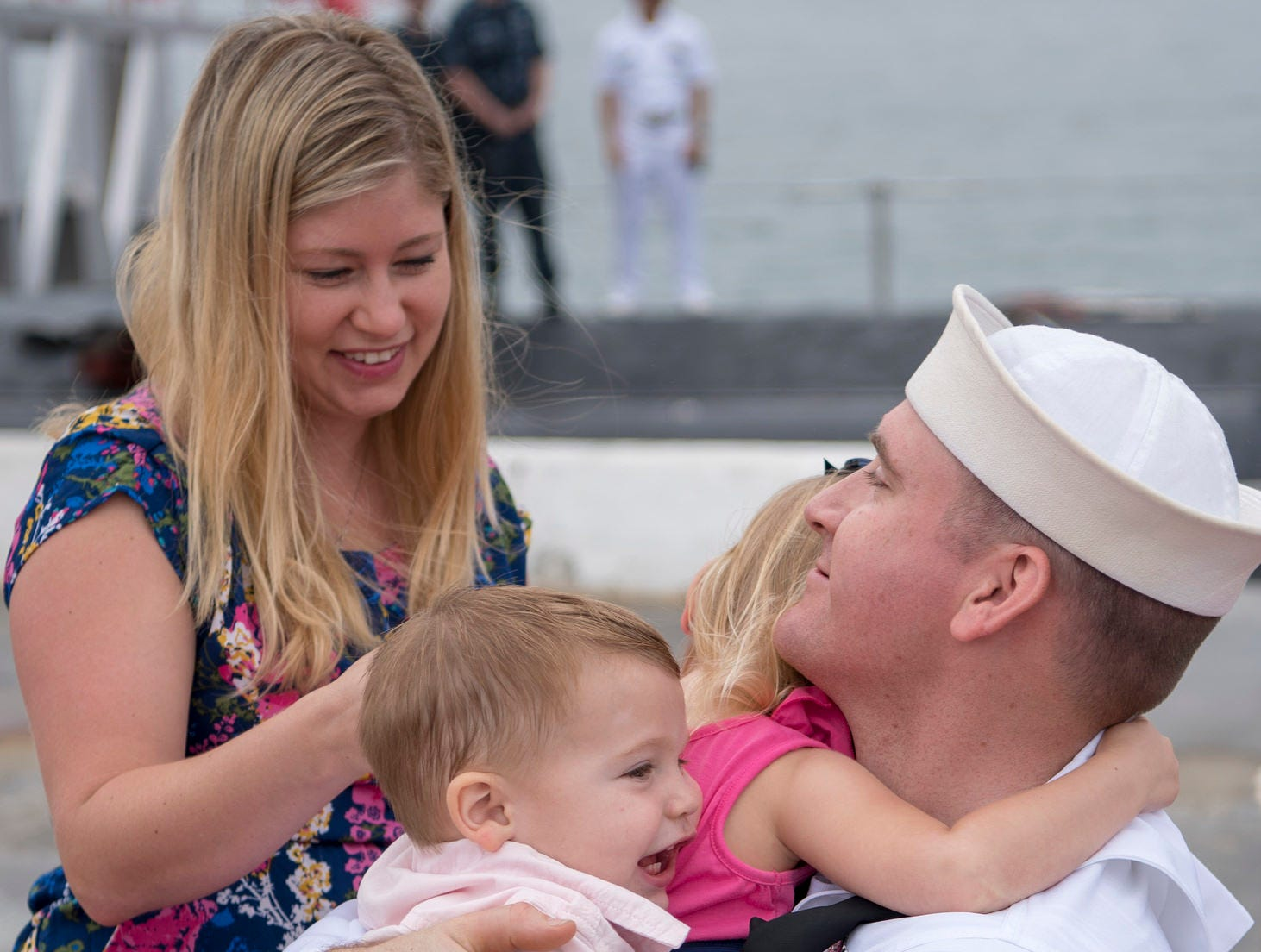 Machinist's Mate (Nuclear) 1st Class Thomas Bolin, of Abilene, hugs his family after completing a deployment aboard the fast-attack submarine USS Texas.