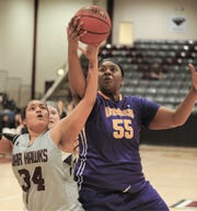 McMurry's Skyler Reyna (34) battles Mary Hardin-Baylor's D'Ashaih Williams (55) for a rebound. UMHB beat the McMurry 88-57 in the American Southwest Conference game Jan. 31 at Kimbrell Arena.