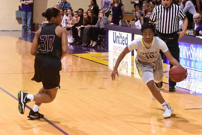 HSU's Taylor Gaffney (10) drives past Concordia's Keturah Taylor (30) during the first half at the Mabee Complex on Thursday, Jan. 31, 2019.