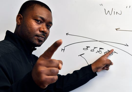 McMurry University assistant coach Larry Dockery draws up a plan for the Los Angeles Rams in the Super Bowl - Win!