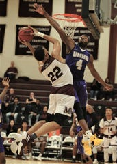 Mary Hardin-Baylor's LaKendric Hyson (4) defends against McMurry's Mike Williams (22) late in the second half. UMHB beat the War Hawks 92-86 in the American Southwest Conference game Thursday, Jan. 31, 2019, at Kimbrell Arena.