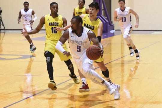 HSU's Keenan Holdman (5) drives towards the lane during the second half against Concordia at the Mabee Complex on Thursday, Jan. 31, 2019. The Cowboys won 76-67 to stay in the ASC West race.