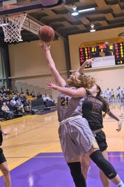 HSU's Kaitlyn Ellis (21) shoots a layup from the baseline during the first half against Concordia at the Mabee Complex on Thursday, Jan. 31, 2019.
