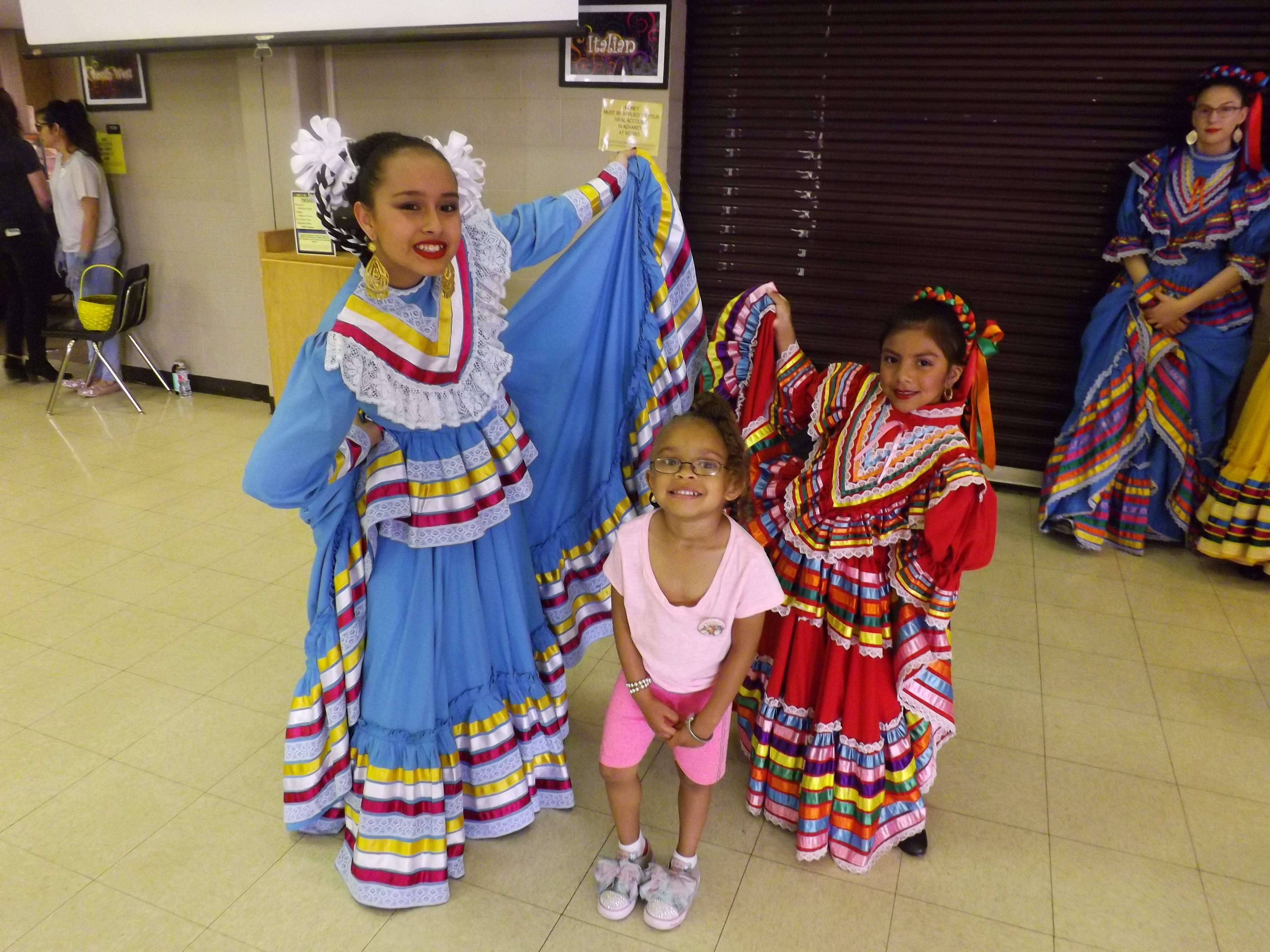 Faith Turner poses with Ballet Folklorico dancers at the Day Nursery of Abilene's annual Mexican dinner.