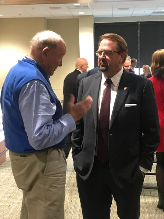 NC Sen. Chuck Edwards, R-Henderson, right, talks to Council of Independent Business Owners member Dewey Andrew at a CIBO meeting Friday, Feb. 1, 2019, at UNC Asheville.