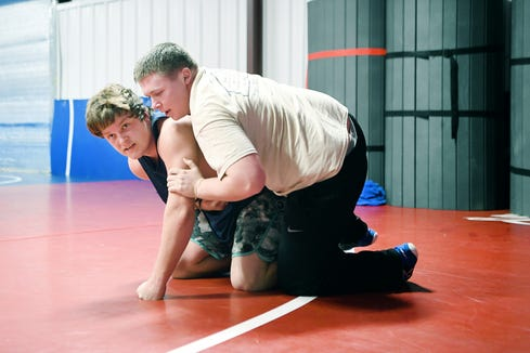 Madison High School senior Colton Roberts wrestles junior Connor Foley during practice at the high school on Jan. 31, 2019.