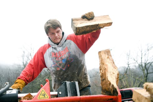 Colton Roberts uses a log splitter to make firewood at his home in Madison County on Jan. 17, 2019. He originally started his firewood business using an axe but the demand became too high and he needed the splitter.