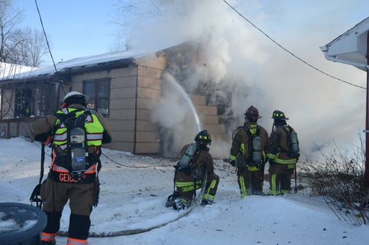 Firefighters from three departments fought a fire on Margaret Street in Battle Creek on Friday, Feb. 1, 2019,