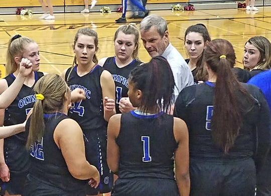 Olympic girls basketball coach Bryan Hanley talks to his team before the second half of Thursday's game against Kingston. The Buccaneers beat the Trojans 54-51 to earn a district playoff berth.