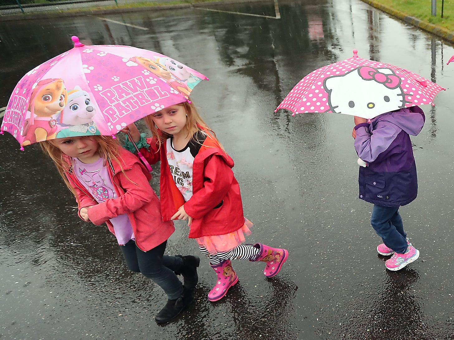 Students in Samantha Klump's pre-kindergarten class at Peace Lutheran School in Bremerton parade through the parking lot with their umbrellas on a rainy Friday, February 1, 2019. Mrs. Klump uses the umbrella parade as part of her lesson plan for when students are learning about the letter U and also uses the parade as an opportunity to teach the proper etiquette on umbrella usage.