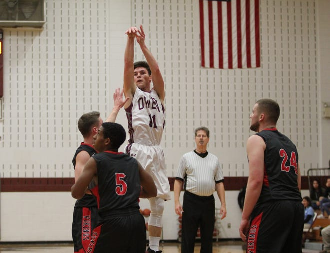 Owen senior Noah Moore puts up a three-pointer against Avery on Jan. 30.