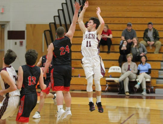 The Warhorses' leading scorer, Noah Moore, delivers a floater over the hand of an Avery defender at Owen on Jan. 30.