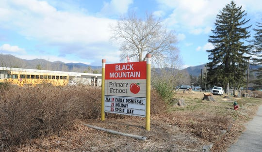 A large space that was once home to several massive trees will become a parking lot, after Buncombe County Schools had the evergreens removed as part of its comprehensive school security plan for Black Mountain Primary.