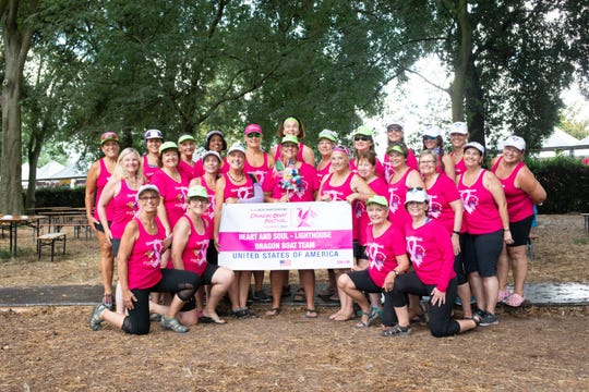 Beth Gitlin, back row (center), is a founding member of the Heart and Soul Dragon Boat Paddling team