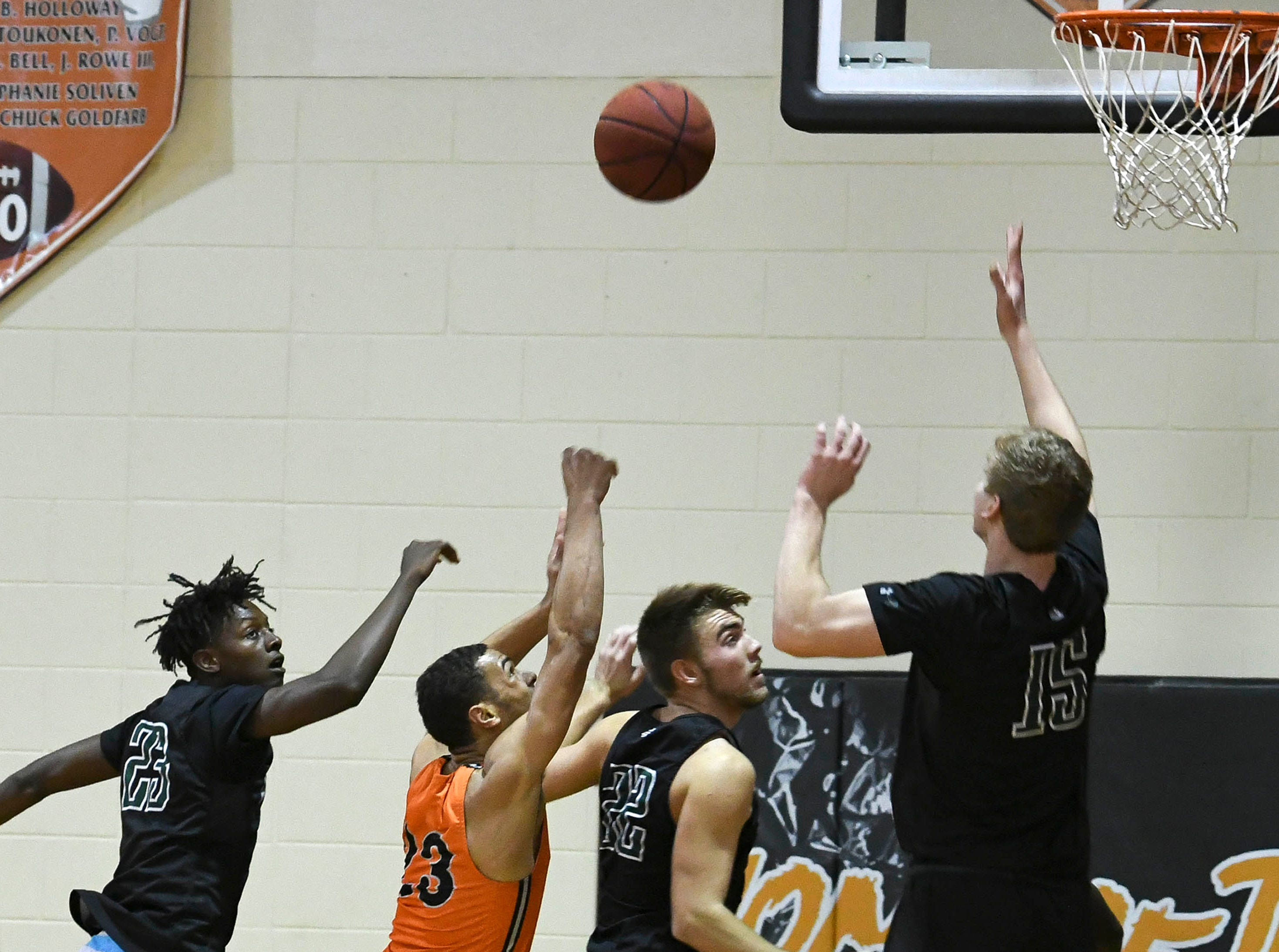 Cocoa's Joseph Cartwright (23) takes a shot in heavy Melbourne traffic during the game Thursday at Cocoa High School.