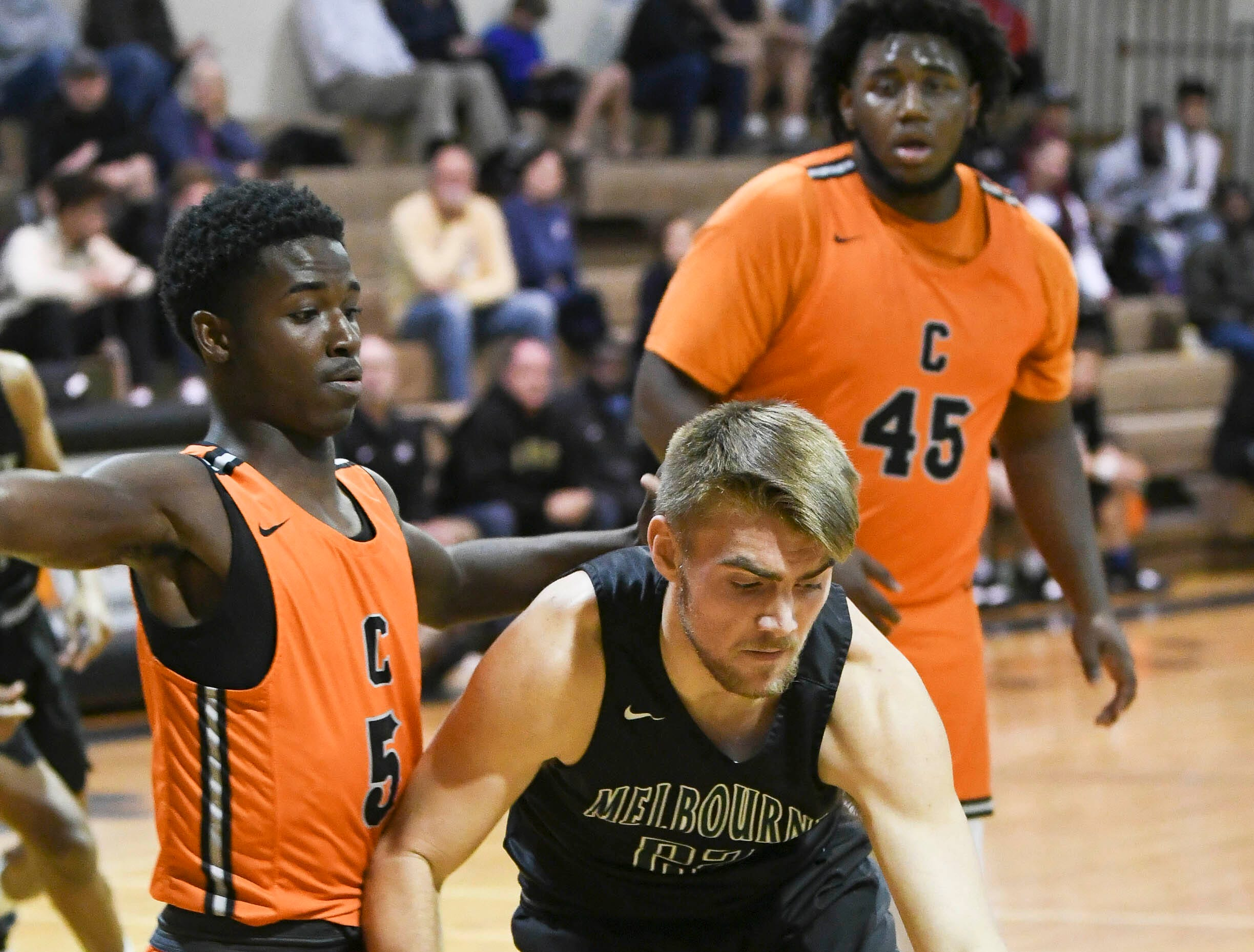 Cocoa's Samarian Bryant guards Travis Madox of Melbourne Thursday at Cocoa High School.