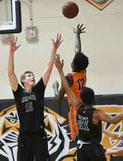 Melbourne's Max Fiedler goes for a shot block in a 2019 game at Cocoa.