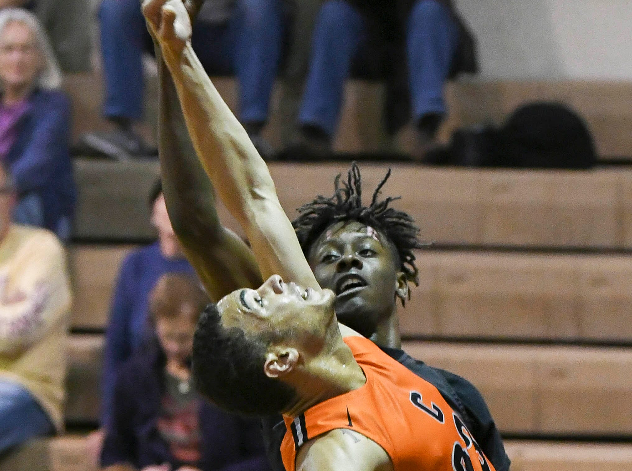 Cocoa's Joseph Cartwright goes high for a rebound during Thursday's game.