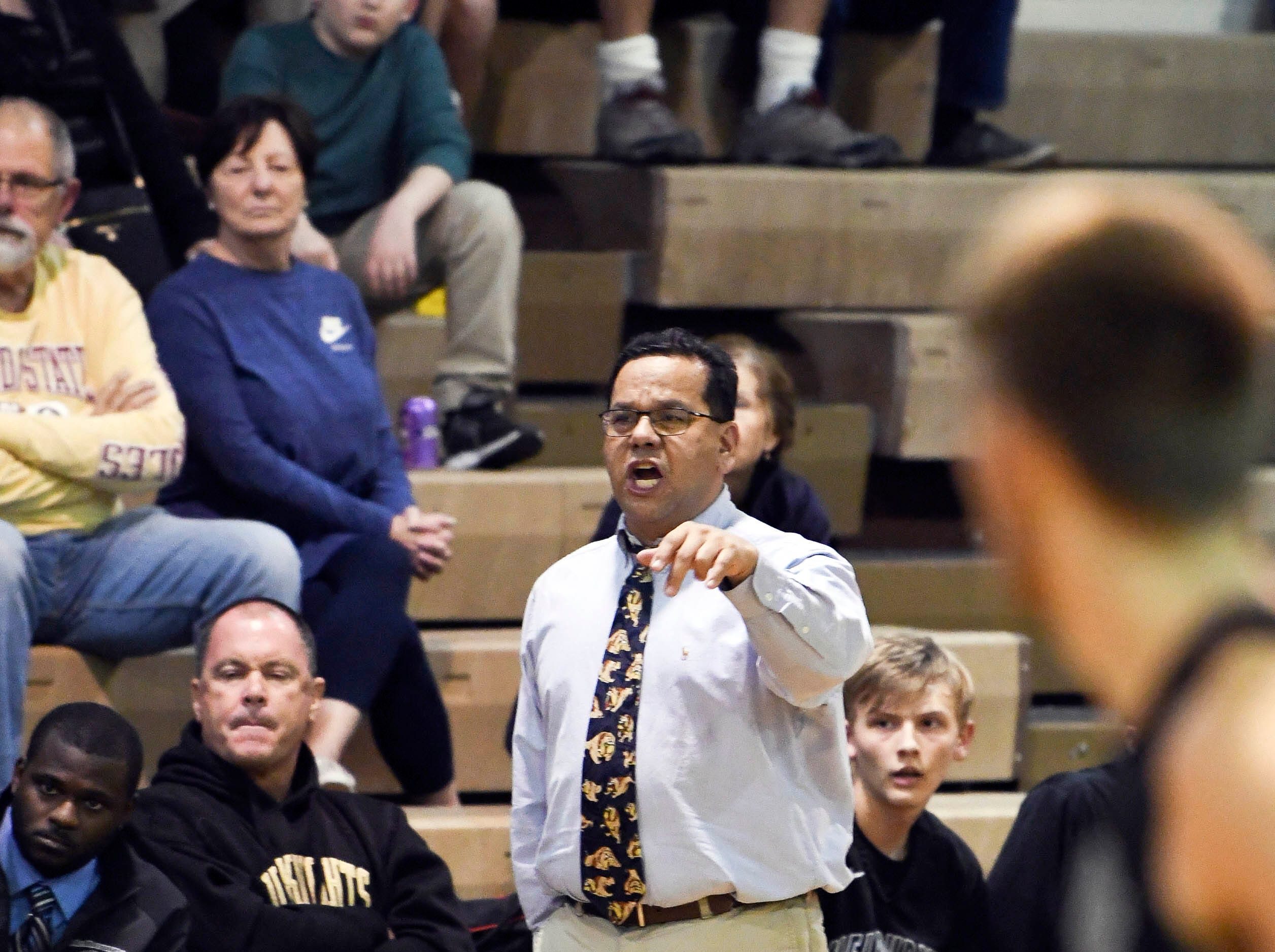 Melbourne boys basketball head coach Mike Soliven instructs his players during Thursday's game at Cocoa High School.