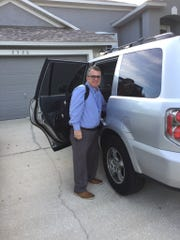 FLORIDA TODAY Executive Editor Bob Gabordi prepares to head to work for the first time since his stroke in November.
