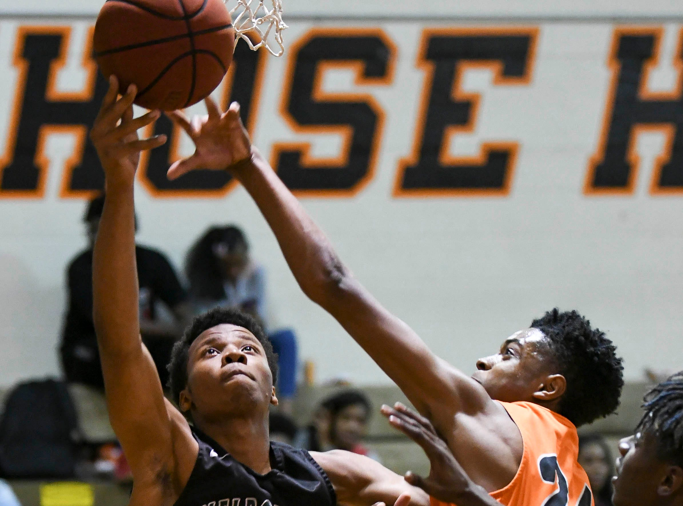 Melbourne's Derion Green of Melbourne shoots around the guard of Kendal Parker of Cocoa Thursday at Cocoa High School.