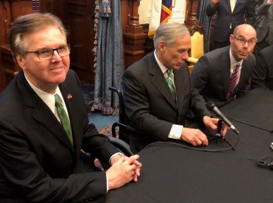 Lt. Gov. Dan Patrick, left, Gov. Greg Abbott and House Speaker Dennis Bonnen call for property tax relief in the Texas Capitol on Jan. 31, 2019.