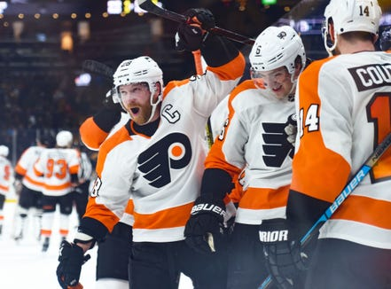 Claude Giroux had the Flyers' first goal in a 3-2 overtime victory over the Boston Bruins to bring their win streak to six.