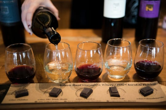 Mary Kate Fitzpatrick sets up a wine and chocolate pairing at Auburn Road Vineyard & Winery Wednesday in Pilesgrove. The chocolate is from 1892 Chocolate in Collingswood.