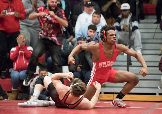 Paulsboro's Shawn Williams celebrates after pinning Hunterdon Central's Vincent Romaniello to win the 160 lb. bout of Thursday's wrestling match held at Paulsboro High School.