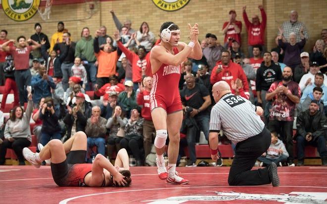 Paulsboro's Santino Morina celebrates after pinning Hunterdon Central's Kyle Barrett to win the 182 lb. bout of Thursday's wrestling match held at Paulsboro High School.