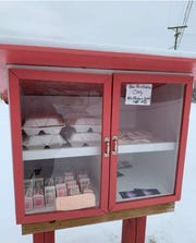 A Blessing Box was filled with warm meals and milk by staff volunteers from the Chillicothe City School District.
