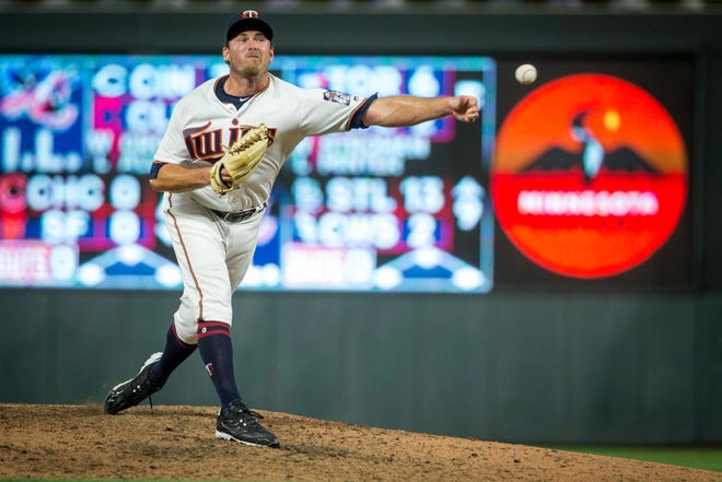 Minnesota Twins relief pitcher Zach Duke (32) throws to the Kansas City Royals in the eighth inning at Target Field.