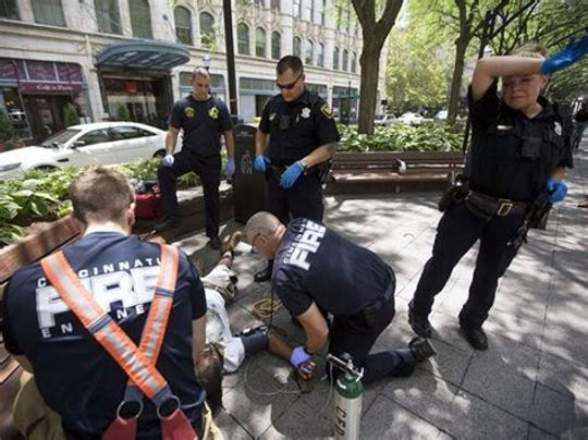 Paramedics give naloxone to an overdosing man in Piatt Park in Cincinnati during the summer of 2017.